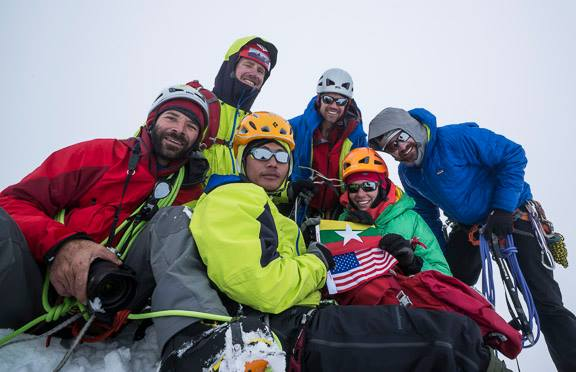 Summit of Gamlang Razi 2013 September 7 Myanmar – American Friendship Expedition First Ascent From centre to clockwise, Climber Poe Pin, Mark Fisher, Eric Daft ( Teton Hd)' , Andy Tyson, Chris Nance, Molly Loomis, @ summit of gamlang razi ( PHOTO CREDIT TO : MARK FISHER / FISHER CREATIVE )